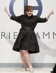 Actress Jamie Brewer walks the runway as first down syndrome model